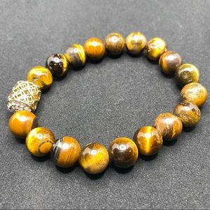 Tiger eye stone with gold tone focal piece